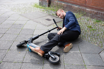 Young Man Accident With An Electric Scooter Wall mural