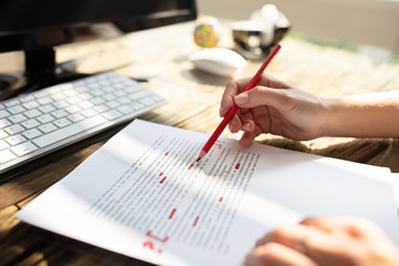 Person Marking Error With Red Marker Wall mural