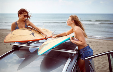 girls ready to surf at the beach.