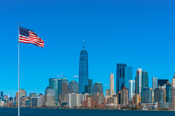 Fototapete - Scene of Flag of America over New york cityscape river side which location is lower manhattan,Architecture and building with tourist and Independence day concept