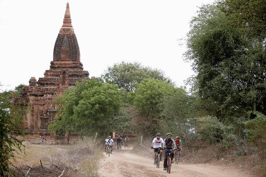 Cyclists tour Bagan by bike to celebrate Bagan being named as an UNESCO World Heritage Site in Bagan,