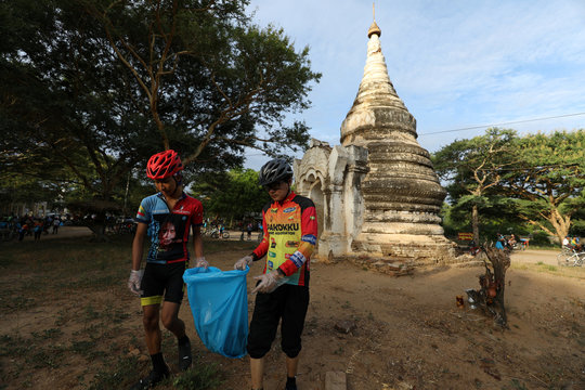 Cyclists pick up trash around pagodas to celebrate Bagan being named as a UNESCO World Heritage Site in Bagan, Myanmar,