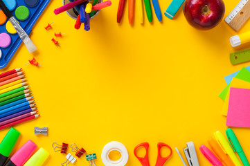 School supplies on yellow background. Back to school concept..