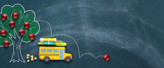 Back to school concept with yellow school bus.