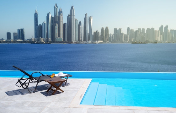 Awesome view of the Dubai Marina from the infinity pool with a deck chair