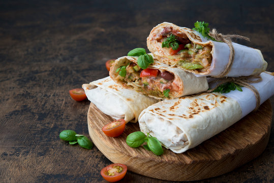 Mexican wrapped burrito with red beans and vegetables