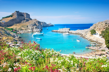 Tuinposter Kust Lindos – panoramic view of St. Paul bay with acropolis of Lindos in background (Rhodes, Greece)