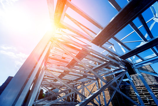 Structure of steel. Building construction on sky background.