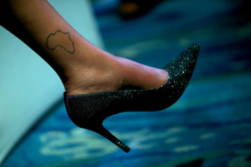 Map of Africa is seen tattooed on a woman's ankle during the closing session of Tony Elumelu Foundation 2019 Entrepreneurship Forum in Abuja