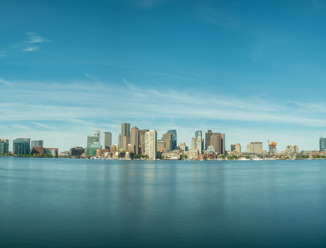 Long Exposure View of Boston Skyline With Mostly Clear Skies
