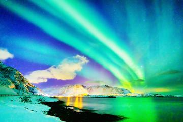 Marvelous natural wonder - Northern Lights or Aurora Borealis. Colorful night scenery of Polar Lights over Norwegian Sea on Lofoten Islands Archipelago in Norway. Winter scene  of dramatic sky. Fototapete