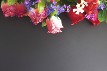 memorial mockup with artificial flowers on a dark background flat lay top view