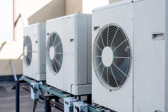 Three mini-split air condtioner condensers