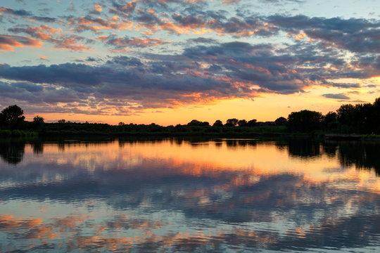 Sunset over lake in Ada Hayden Heritage Park, Ames, Iowa, USA.