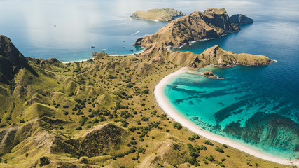 Foto auf AluDibond Insel Aerial panoramic view of Padar island in Komodo National Park, Indonesia. Drone shot, top view. Green hills and amazing beautiful coastline. Tropical background.