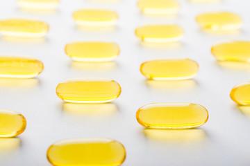 Vitamin, essential oils, dietary supplement yellow pills