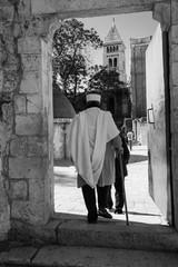 Man entering the Ethiopioan Monastrey at teh Church of the Holy Sepulchre in Jerusalem