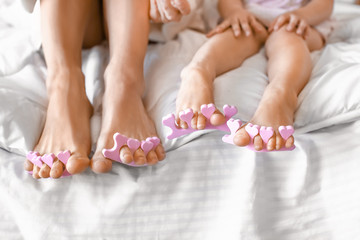 Wall Murals Pedicure Cute daughter with mother making pedicure at home