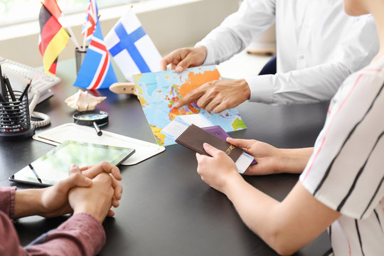 Young couple with travel agent in office