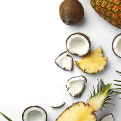 Fototapete - Composition with coconuts, juicy pineapples and leaves on white background, top view