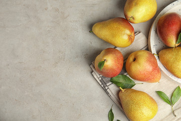 Fototapete - Ripe juicy pears on grey stone table, flat lay. Space for text