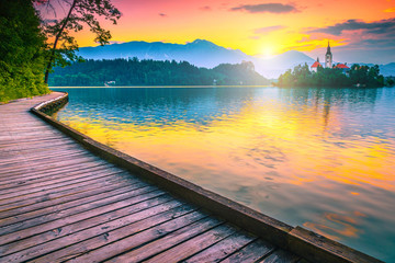 Wall Mural - Breathtaking Pilgrimage church and lake Bled at sunrise, Slovenia, Europe