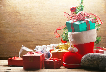 Gift boxes and Santa Claus shoes decorate on Christmas theme.