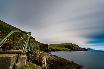 Profile of Mykines susspension bridge in Faroe Islands, long exposure