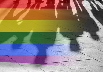 Gay Rights Shadows of People and Rainbow Flag as Symbol Right, Freedom - conceptual Picture about anonymous Gay Lesbian and Transgender in the World