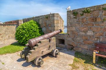 La Coruna, Spain. Medieval cannon in combat position in the castle of San Anton