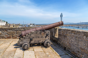 La Coruna, Spain. Medieval cannon on the wall of the castle of San Anton
