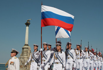 Russian sailors march during the Navy Day parade in the Black Sea port of Sevastopol