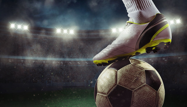 Close up of a soccer striker ready to kicks the ball at the stadium