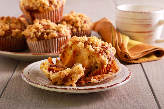Fruit muffins with crumble topping, served