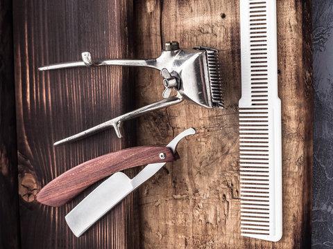barber tools. vintage clipper straight razor. hairbrush.