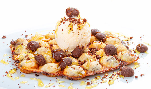 Bubble waffles with ice cream and chocolate chip cookies. On white background