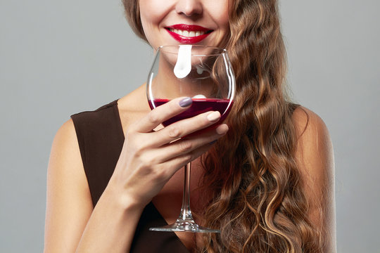 smiling woman with glass of wine