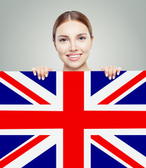 Portrait of happy pretty girl with UK flag background. Young wom