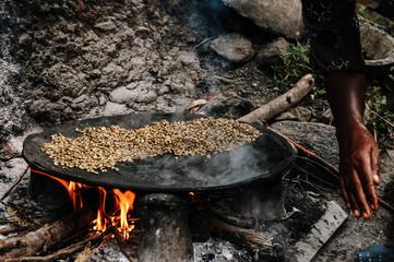 Traditional Ethiopian coffee beans roasting, Roasted coffee bean pile