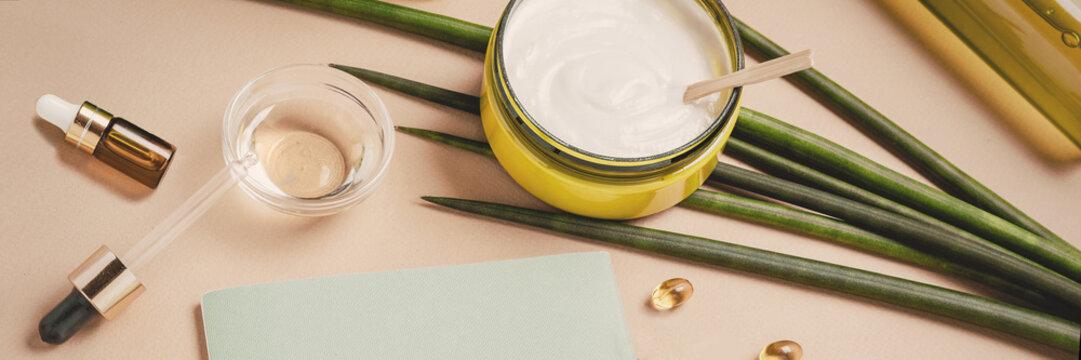 Natural cosmetics. Serum, shampoo, hair mask. Organic care concept. Flat lay, copy space