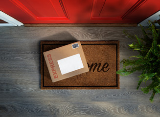 Express parcel delivery outside front door. Overhead view. Add your own copy