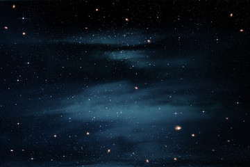 Stars in the Night Sky With Cloudy Nebula