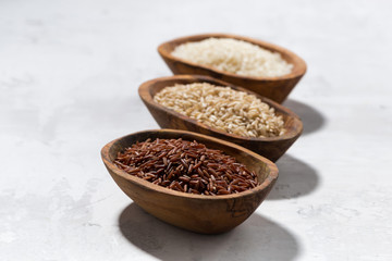 three kinds of dry rice in wooden bowls, top view