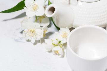 white pialat, tea and jasmine. japanese tea party, top view