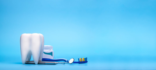 White healthy tooth, different dentist tools for dental care. Dental banner or background.- Image