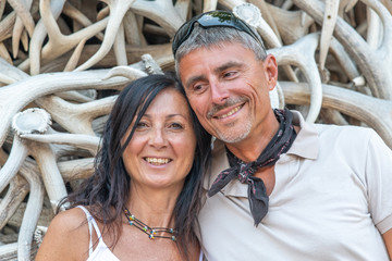 Happy couple relaxing and making pictures in Jackson Hole main square