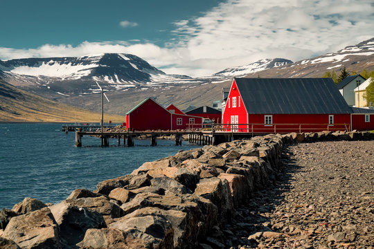 Old red classic Icelandic houses at the fish port of Eskifjordur. Easternfjords Iceland.