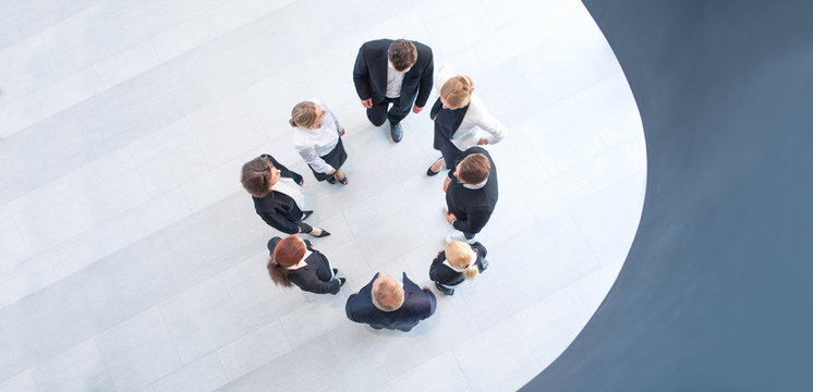 Business people forming circle