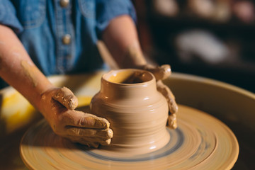 Pottery workshop. A little girl makes a vase of clay. Clay modeling Fototapete
