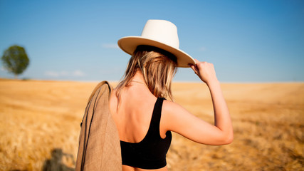 girl in style hat at countryside wheat field
